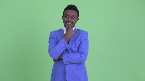 Thumbnail for Happy Young African Businessman Thinking