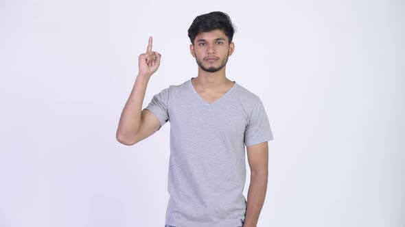 Thumbnail for Young Handsome Bearded Indian Man Pointing Up