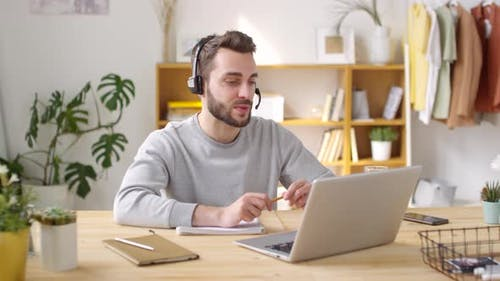 Man Working from Home and Smiling for Camera