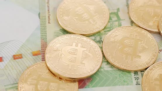 Thumbnail for Bitcoin and Hong Kong banknote in spinning