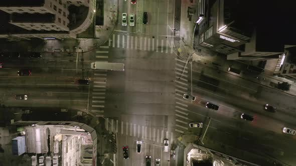 Thumbnail for AERIAL: Overhead View on Intersection Street with Big Construction Site and Holes in Ground at Night