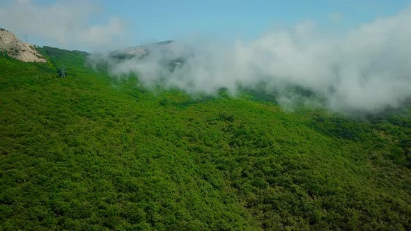 Thumbnail for Aerial View of Lush Green Rain Cloud Cover Rain Forest Mountain During the Rainy Season in the