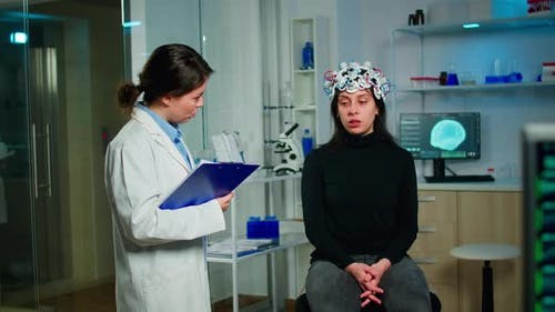 Medical Doctor and Patient Discussing About Symptoms of Disease