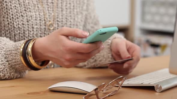 Thumbnail for Young Woman Buys Online Using her Phone