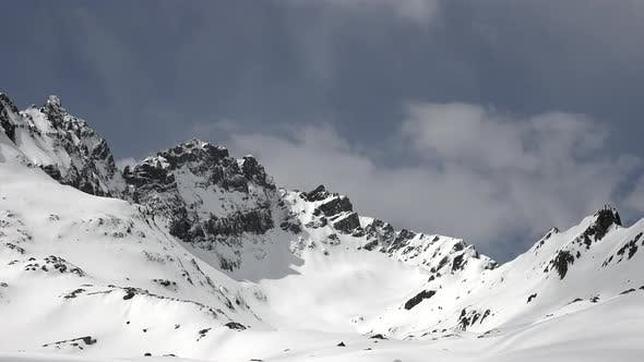 Thumbnail for High Altitude Rocky Snowy Mountain Ridge in Sunny Winter Day