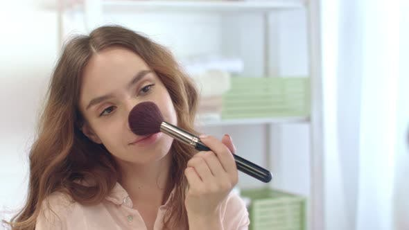 Thumbnail for Sensual Woman Applying Powder By Cosmetic Brush While Morning Makeup in Bathroom