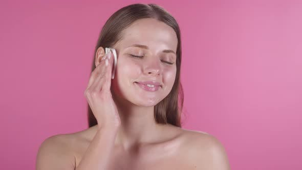 Beautiful Woman Wiping Face with Wet Wipe