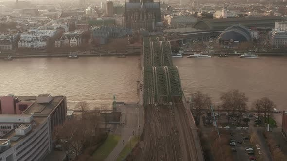 Thumbnail for AERIAL: View Over Cologne Hohenzollern Bridge and Cathedral in Beautiful Hazy Sunlight