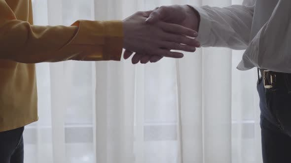 Thumbnail for Close-up of Caucasian Business People Handshake. Unrecognizable Man and Woman Shaking Hands Indoors