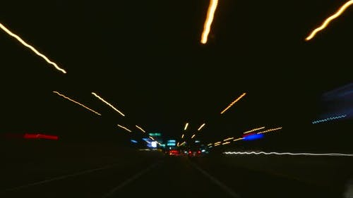Time lapse driving light on road