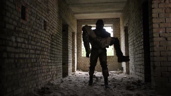 Thumbnail for Soldier Carrying Wounded and Unconscious Comrade