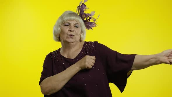 Thumbnail for Positive Happy Senior Old Woman Enjoying Party Music, Moving in Energetic Dance, Celebrating Success