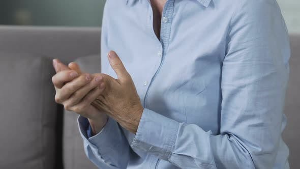 Cover Image for Nervous lady rubbing hands, visiting doctor to discuss psychological problems