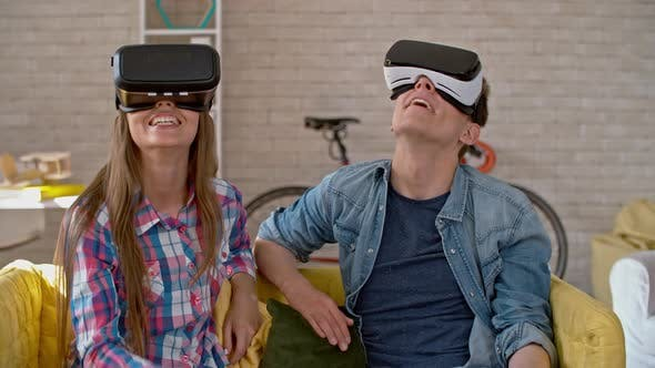Cover Image for Young Man and Woman Enjoying Virtual Reality