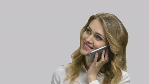 Happy Young Cheerful Lady Talking on Phone