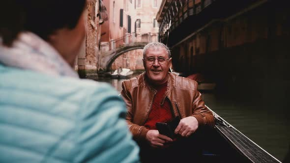 Thumbnail for Happy Smiling Senior European Male Tourist Listening To Older Woman in Gondola During Venice Canal
