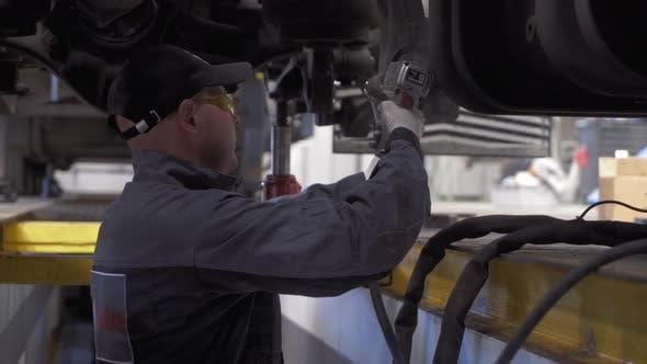 Thumbnail for Auto Mechanic Repairs Truck Suspension