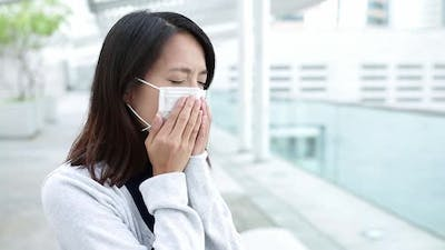 Young woman getting sick