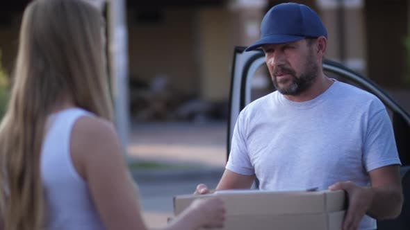 Thumbnail for Pizza Delivery Man Giving Boxes To Female Client