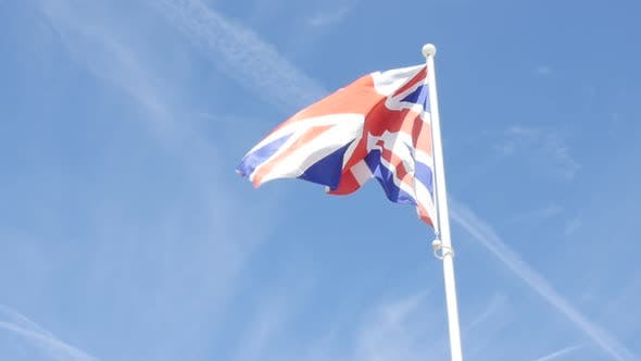 Thumbnail for Slow motion waving United Kingdom famous striped flag in front of blue sky 1920X1080 HD video - Unio