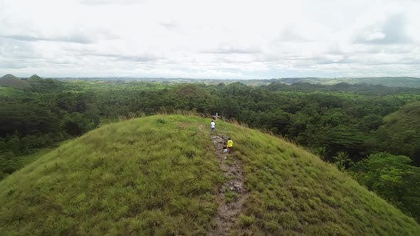 Thumbnail for Aerial view group people hiking Chocolate Hills Complex, Batuan, Philippines.