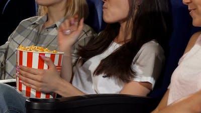 Three Female Friends Watching Movies at the Cinema