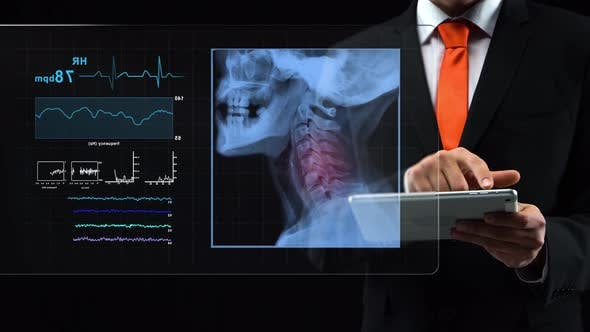 Thumbnail for Doctor Uses Holographic Interface, Working with a Tablet, Then Turn-on Touchscreen and Appears