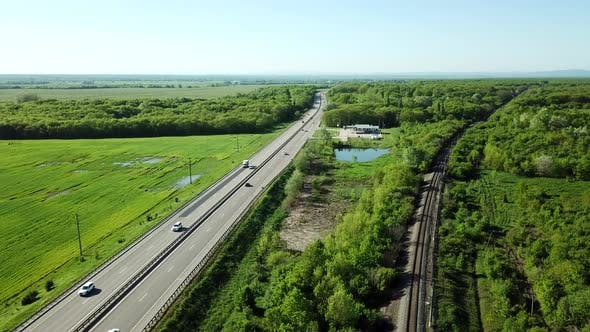 Aerial View of Cars and Truck Drive Along the Highway
