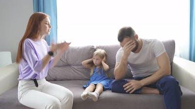 Young Caucasian Parents Argue at Home.