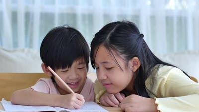 Asian Children Doing Homework Together