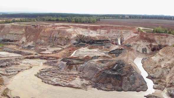 Thumbnail for Opencast mining quarry with lots of machinery. Iron ore quarry from bird's eye view.