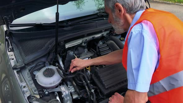 Thumbnail for Senior Man Wears Warning Vest and Controls Engine of the Car - Closeup