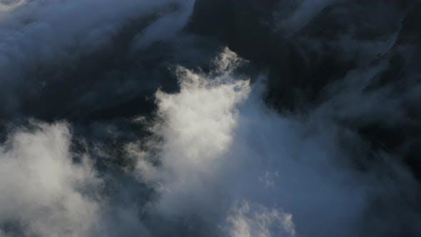 Aerial View Of Clouds Rolling In Evening Sunlight In Caldera de Taburiente National Park La Palma