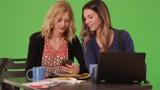 Thumbnail for Lovely traveling women navigating location with smart phone on greenscreen