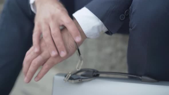 Thumbnail for Close-up of Male Hand Chained To Attache Case with Handcuffs. Unrecognizable Secret Agent with