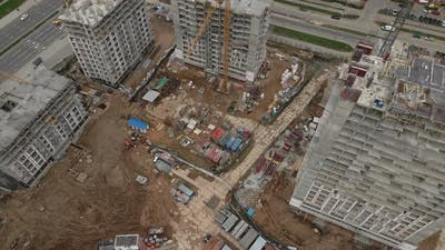 Flying Over A Construction Site In An Arc. Modern Urban Development.