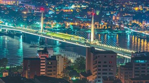 Timelapse Ataturk bridge, metro bridge and golden horn at night in Istanbul, Turkey