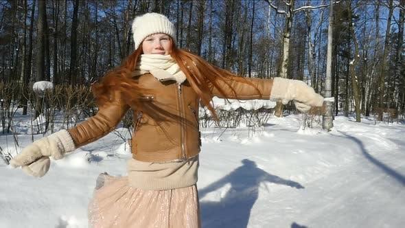 Redhead Teenage Girl, Child Having Fun On Winter Walk. Happy Teen Girl Spinning In Winter Park