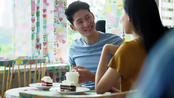 Thumbnail for Handheld view of young couple in a cafe. Shot with RED helium camera in 8K