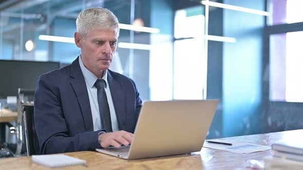 Thumbnail for Middle Aged Businessman Get Shocked While Working on Laptop