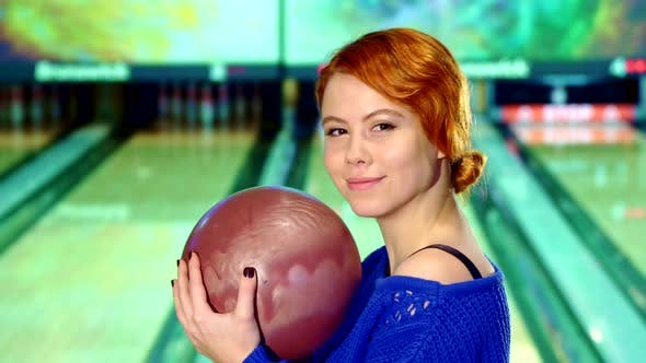 Thumbnail for Girl Smiling with Bowling Ball in Her Hands