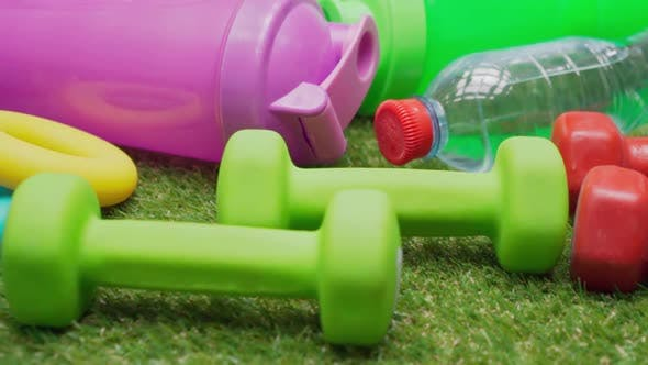 Fitness Equipment Set on Green Grass Close Up