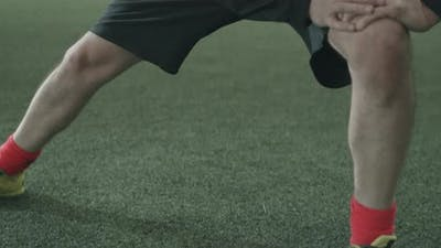 Football Player Preparing Training on Indoor Field