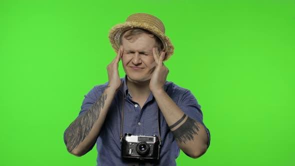 Thumbnail for Portrait of Man Tourist Photographer Having Headache. Chroma Key