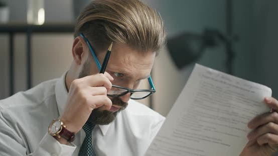 Thumbnail for Shocked Businessman Checking Document