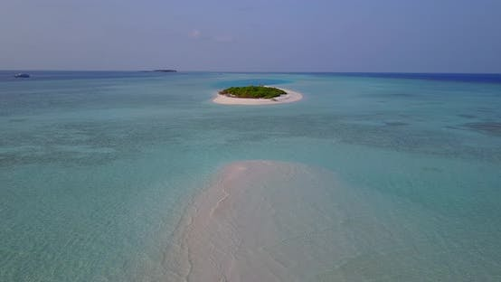 Wide fly over clean view of a sunshine white sandy paradise beach and blue sea background in best qu