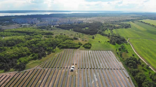 Thumbnail for Aerial View on Solar Power Station in Green Field Near Small City at Sunny Day
