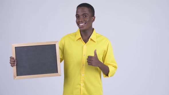 Thumbnail for Young Happy African Businessman Holding Blackboard and Giving Thumbs Up