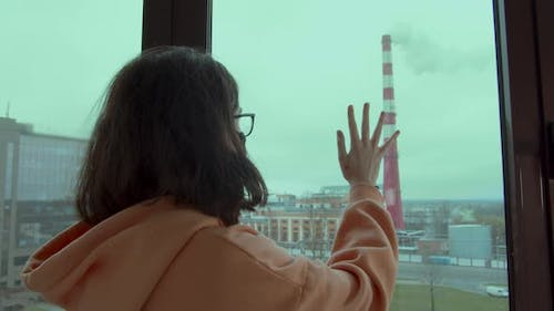 Sad Girl Looks at the Chimney with the Release of Chemical Waste Into the Sky Environmental Disaster