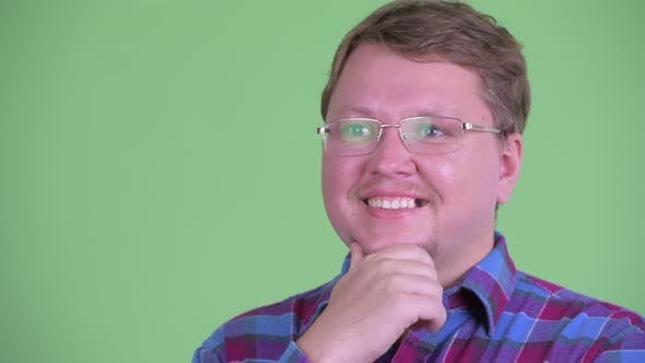 Thumbnail for Face of Happy Overweight Bearded Hipster Man Thinking and Looking Up